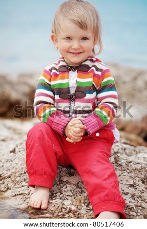 Child playing at the beach - stock photo
