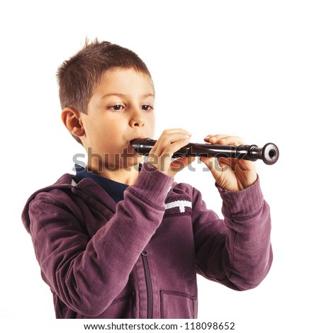 Child playing flute, isolated on white background.