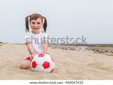 Child playing in beach soccer.