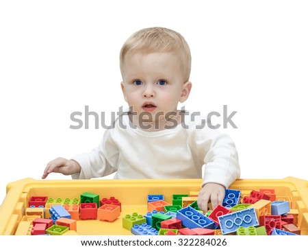 child playing in the plastic constructor isolated on the white - stock photo