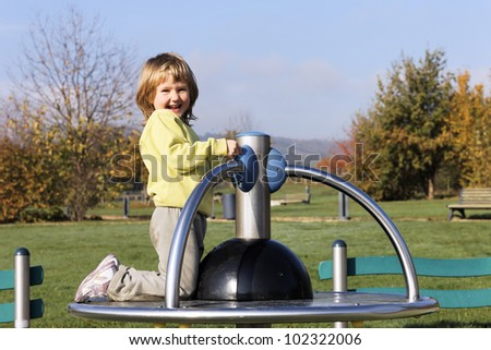 child playing on playground in a park - stock photo