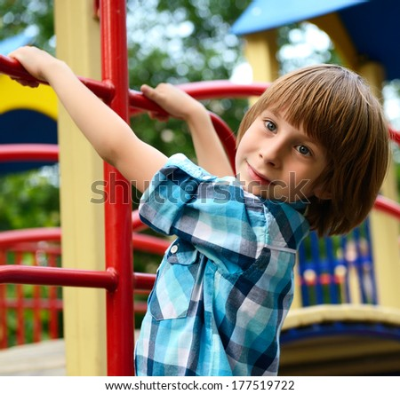 child playing on  playground in summer outdoor park - stock photo