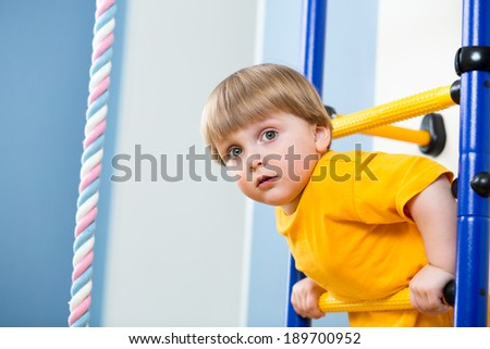 child playing on sports equipment