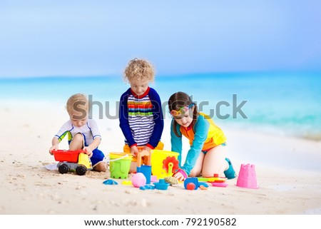 Child playing on tropical beach. Little girl and boy dig sand at sea shore. Family summer vacation. Kids play with water and sand toys. Ocean and island fun. Travel with young children. Asia holiday