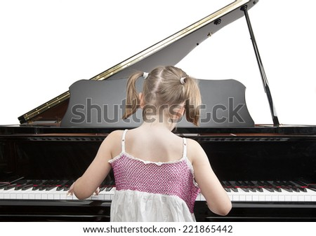 Child Playing Piano - stock photo
