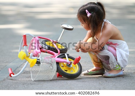 Child, Playing, Playground. bike have a problem - stock photo