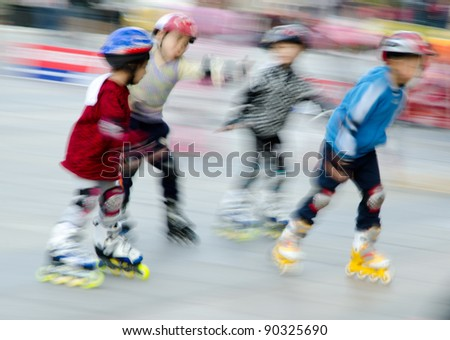child playing rollerblade blur motion - stock photo