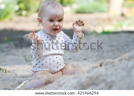 Child playing sand on playground. - stock photo