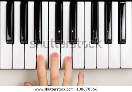 Child Playing the Piano - stock photo