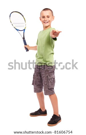 Child playing training with a field tennis raquet, studio full length portrait - stock photo