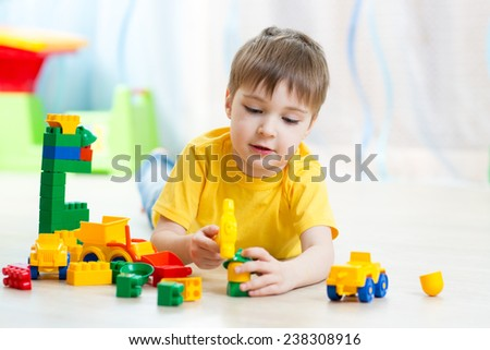 child playing with block toys at home or kindergarten - stock photo