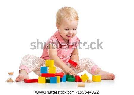 child playing with block toys over white background