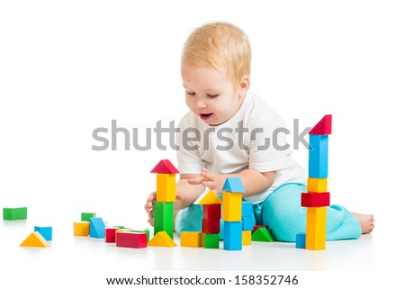 child playing with block toys over white background - stock photo