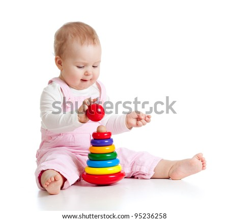 child playing with color pyramid toy - stock photo
