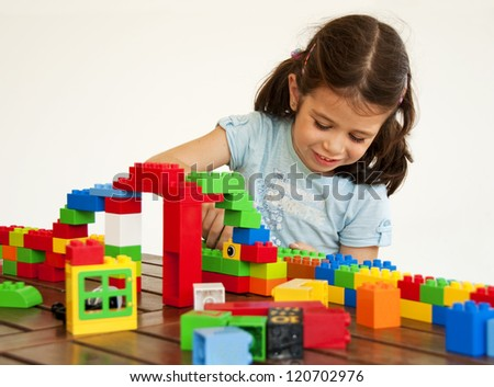 Child playing with construction blocks - stock photo