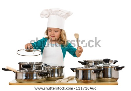 Child playing with cooking bowls and chef hat - isolated - stock photo