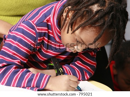 Child playing with crayons - stock photo