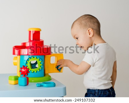 Child playing with educational cup toys.  - stock photo