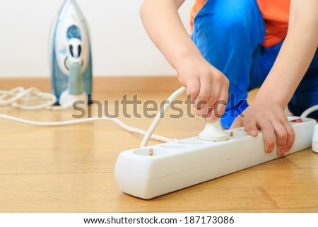 child playing with electricity, kids safety concept - stock photo