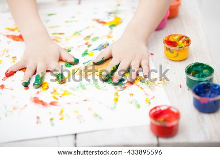 child playing with paint close up