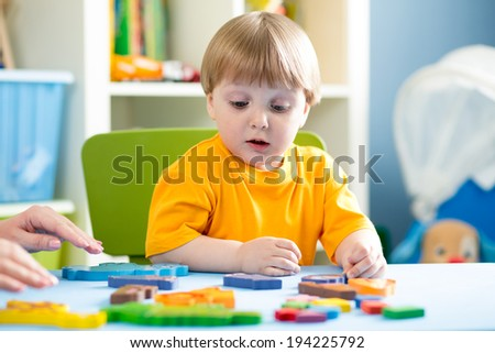 child playing with puzzle toy indoor