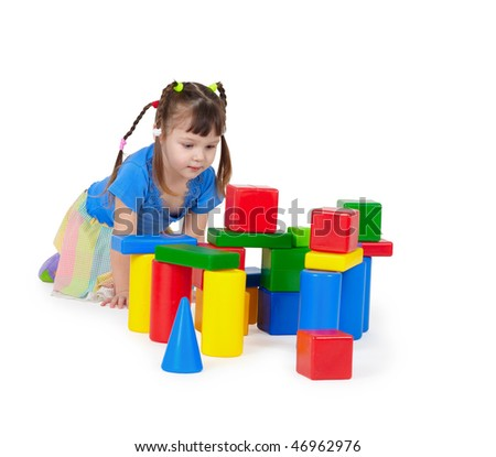 Child playing with toys isolated on white background - stock photo