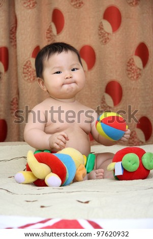 child plays.  Asian. - stock photo