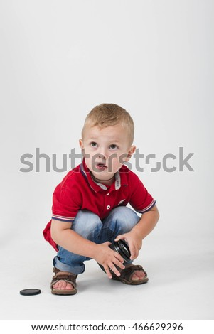 child plays Camera Lenses