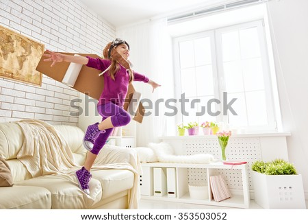 child plays in an astronaut costume and dreams of becoming a spaceman. - stock photo