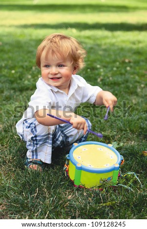 child plays on a drum