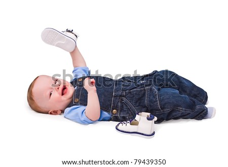 child plays with his first boots - stock photo