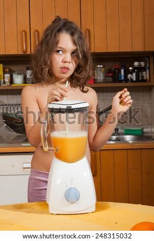 child portrait in the home kitchen  - stock photo