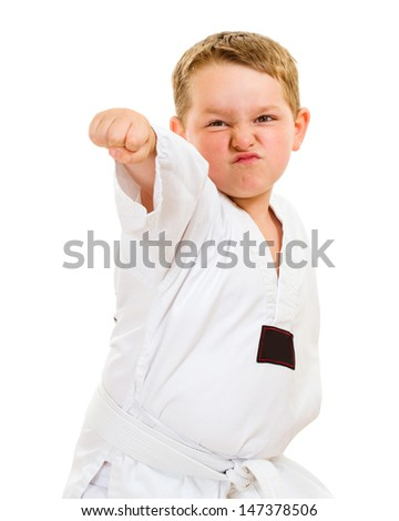 Child practicing his taekwondo moves isolated on white - stock photo