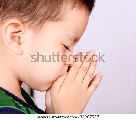 Child pray over white background. Beauty image - stock photo