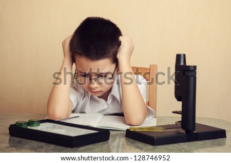 child prodigy is  ponder over a problem - stock photo