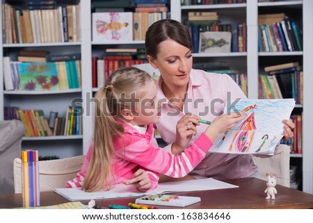 Child psychologist with a little girl, a child draws - stock photo
