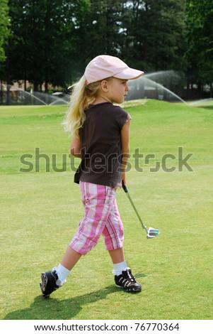 child putting golf ball - stock photo