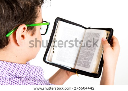 child reads the Bible - stock photo