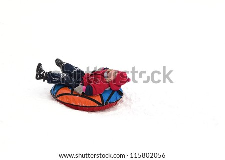 child relaxing after sliding - stock photo