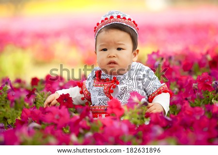 Child relaxing in the park. - stock photo