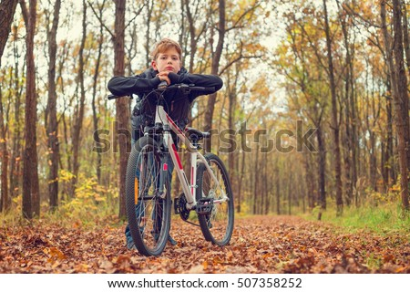 Child resting on his bike