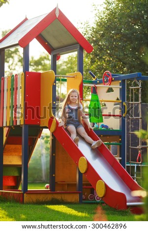 child riding on the hill - stock photo