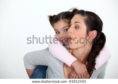 Child riding piggyback - stock photo