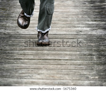 child running: boots and legs on wood