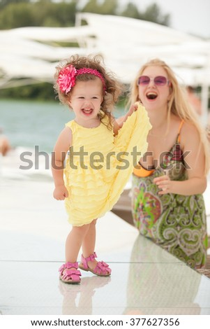 child runs away from his mother - stock photo