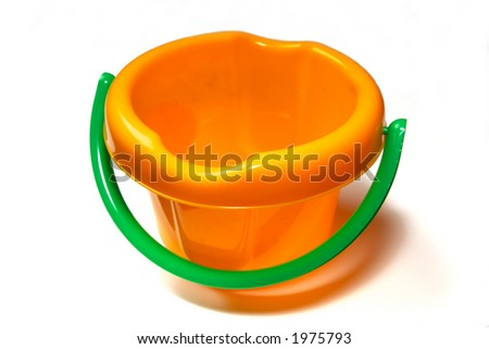 child's bucket for the games in a sand-box
