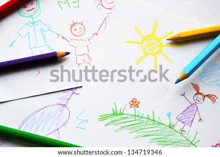 Child's drawings and colored pencils - stock photo