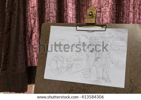 Child's drawings on sketch board - stock photo
