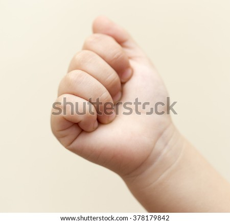 child's hand on a white background.