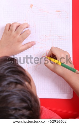 Child's hand painting on a paper. Yellow color - stock photo